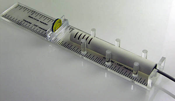 Radioisotope/GM tube calibrated sled