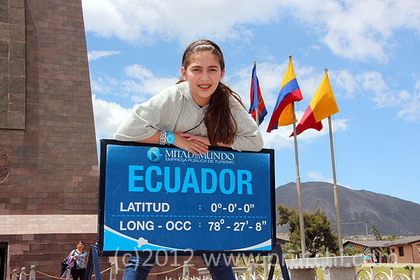 "Abigail Prutchi at the official ""Mitad del Mundo"" monument commemorating the 18th Century French Geodesic Mission marking of the Equator"