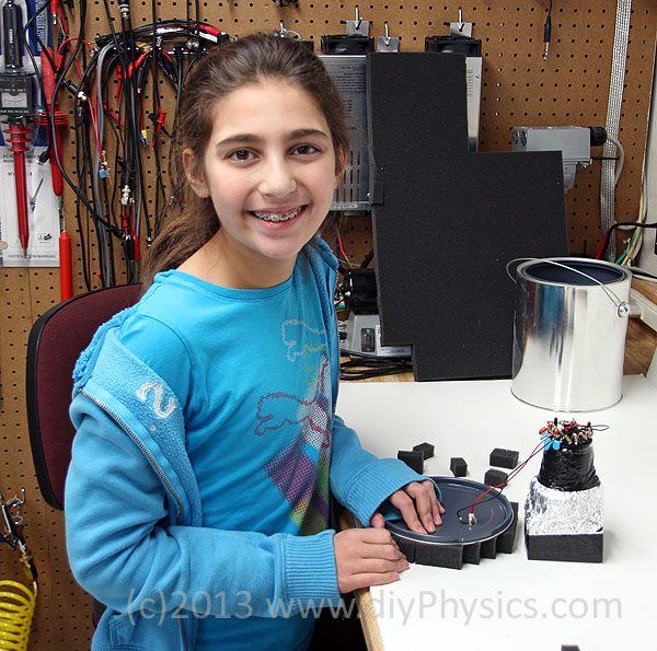 Abigail Prutchi cutting foam retainers for the PMT/scintillator assembly