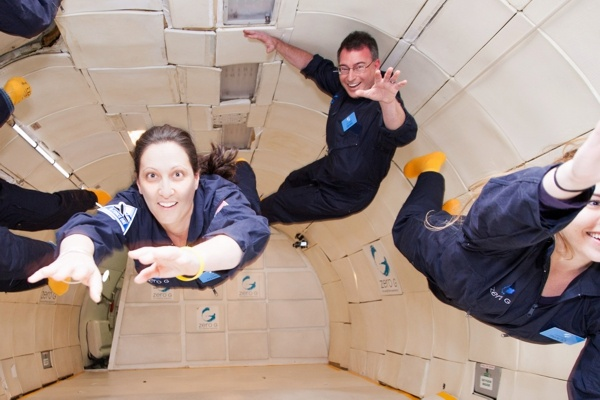 "Dorith and David Prutchi floating in zero g on board the ""G Force One"""
